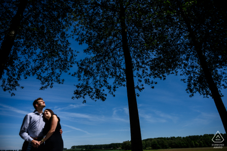 De Klinge Engagement Portrait of a couple in good light and silhouetted trees