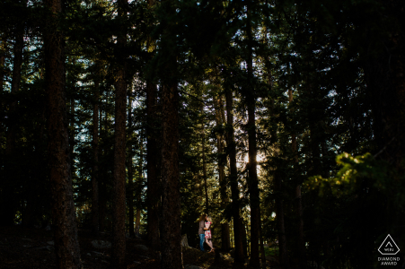 Echo Lake Park Couple standing in the woods of CO