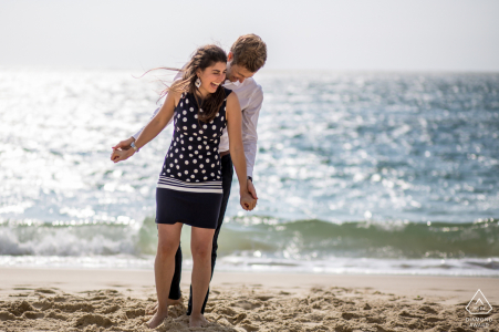 BASSIN D ARCACHON FRANCE Two lovers having fun on a beach during engagement session