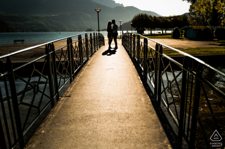 Annecy lake - France couple portrait on the shores of Lake Annecy, on a small pedestrian bridge
