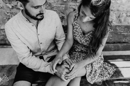 Gesture of stroking the hand during engagement portraits in Castellane - Alpes de Haute Provence