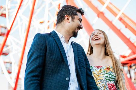 Istanbul, Turkey couple having fun in the fun fair during pre-wedding portrait session