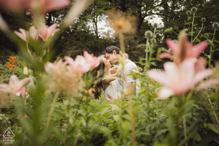 Engagement kiss in the garden at Central Park, NYC