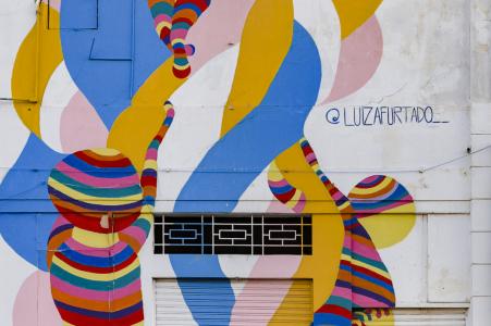 Painted building art couple engagement image from Porto Maravilha, Rio de Janeiro, Brazil