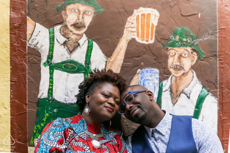 Street art engagement image from Helen, GA of couple posing with wall art