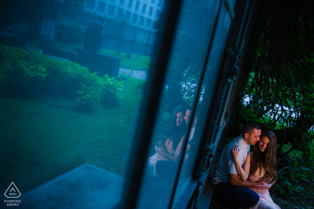 This couple huddles together during their e-photo session at the garden in front of the National Art Gallery in Sofia