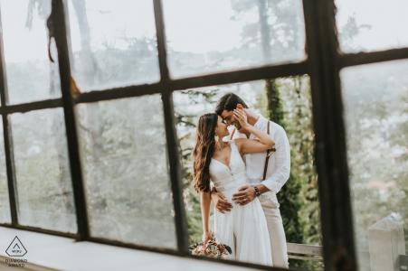 Istanbul romantic engagement portraits shot through damaged windows