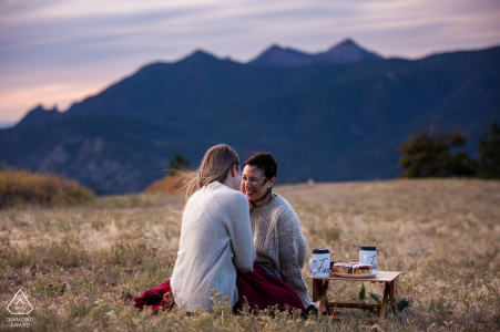 The CO couple share a laugh after just getting engaged at sunrise in the mountains of Boulder
