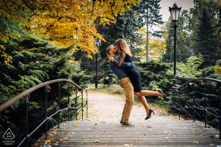 Pre wedding photography from Zrodliska Park, Lodz, Poland of Lovers kissing on the bridge.