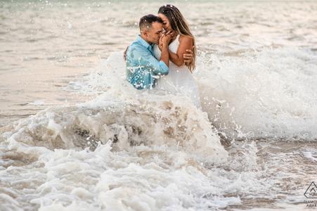 Praia de Carro Quebrado, Alagoasengagement photo session in the crashing waves of the beach with a big splash