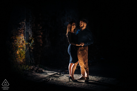Lodz, Poland Lovers standing in a loving embrace in the twilight for a night engagement photo