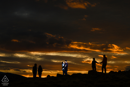 Rocky Mountain National Park sunset photo of the engaged couple having Their parents tagged along for the shoot and were getting antsy, so they got incorporated into a photo
