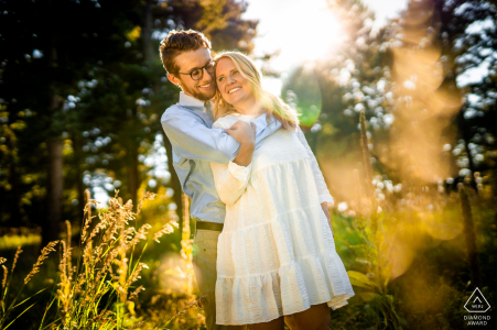 Couple embrace during their engagement session at Meyer Ranch Park in Morrison, Colorado