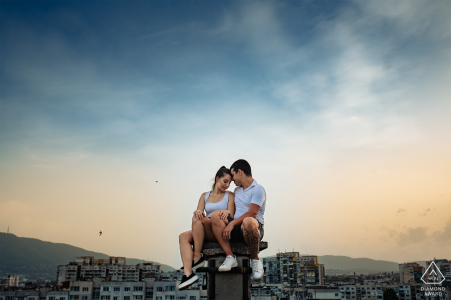 Bulgaria pre wedding portrait session with engaged lovers on a Sofia Rooftop at sunset