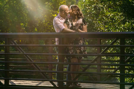 CO pre wedding and engagement photography in the afternoon light at Lair O the Bear park, Idledale with a couple posing on a bridge