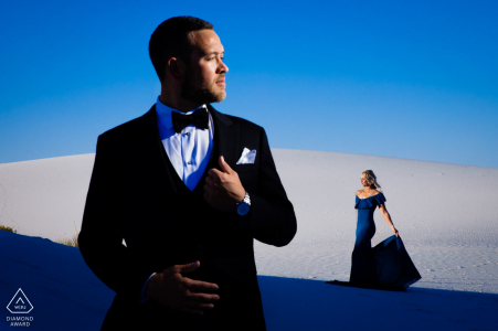Formal engagement portrait with a posed couple in nice lighting at The White Sands National Monument
