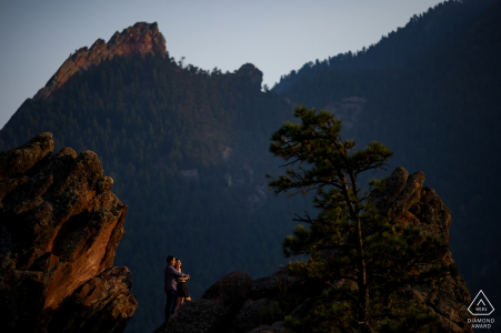 Colorado pre-wedding photoshoot with an engaged couple posing together on Flagstaff Mountain during their Boulder engagement session