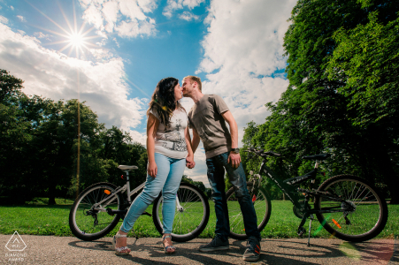 BG engagement photoshoot & pre-wedding session at the Borisova gradina park in Sofia, Bulgaria showing a couple who love to ride a bike in the park on the weekends
