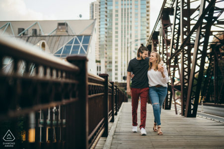 IL pre wedding and engagement photography on the Kinzie Street Bridge in Chicago of a couple walking together