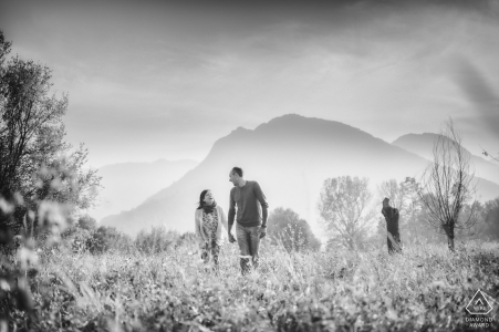 IT pre-wedding photo session with an engaged couple walking in the fields of Schio (Vicenza - Italy) Countryside