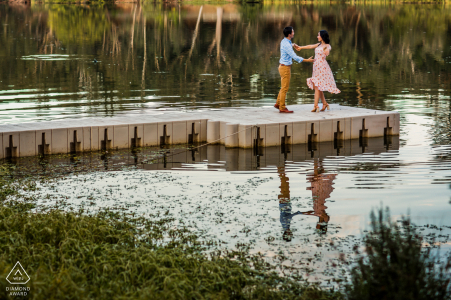 California pre-wedding photo session with an engaged couple and The cats with Dancing feet reacting to the beautiful lake view