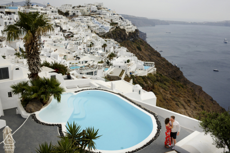 Greece pre-wedding photo session with an engaged couple in the cliff buildings of santorini, greece