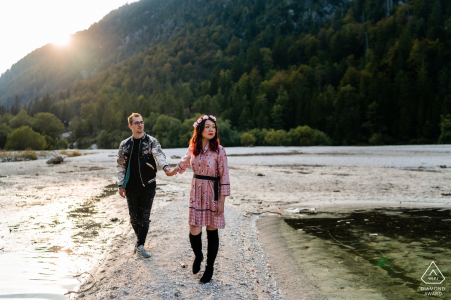 Lago del Predil, Udine, Italy pre-wedding photo session with an engaged couple doing some Sunset walking