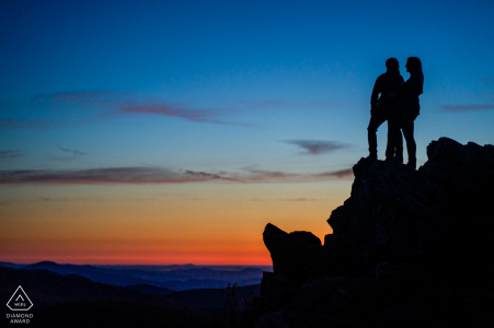 Virginia sunset engagement photoshoot & pre-wedding session at Hawksbill Mountain, Shenandoah National Park, VA as The couple hiked to the tallest point in the Shenandoah and hold hands