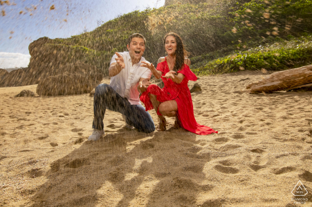 Puerto Rico couple playing with sand at the beach in Tunel Guajataca, Isabela for a prewedding session