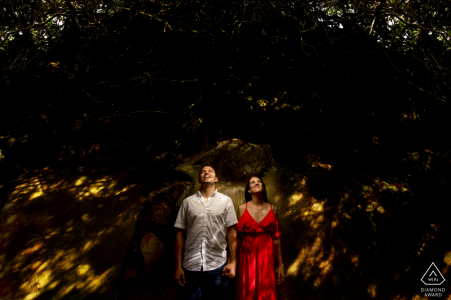 Tunel Guajataca, Isabela, Puerto Rico couple with The small shapes of sunlight plus one light during a creative pre-wed portrait shoot