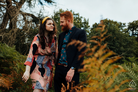 Wollaton Park, Nottingham Couple walking through ferns during a pre-wed colorful photo session