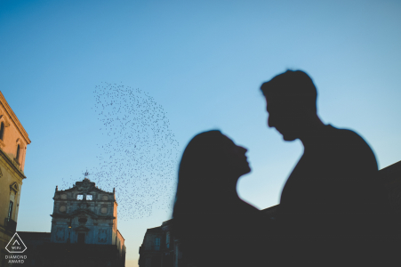 Siracusa love in ortigia island - sicily couple during a pre-wed engagement photo session with birds in flight