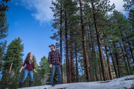 Fallen Leaf Lake, California Girlfriend follows him up a fallen tree at fallen leaf lake for a pre-wed picture