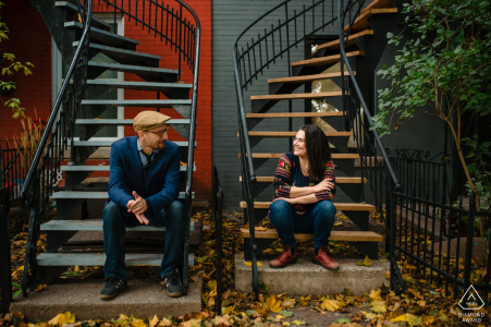 Montreal, Quebec couple sitting on outdoor stairs during pre-wed photo shoot