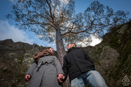 Rocher du Falkenstein outdoor couple photo session before the wedding day showing a low camera angle with a centered, lone tree