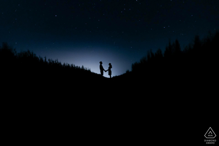 Croatia night couple portrait while holding hands and silhouetted