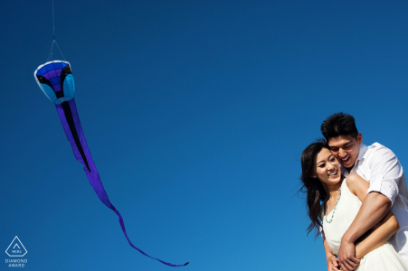 Bakers Beach, San Francisco pre wedding portrait session with a flying kite