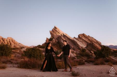 Desert couple portrait at Vasquez Rocks, California wandering the landscape and the rough terrain