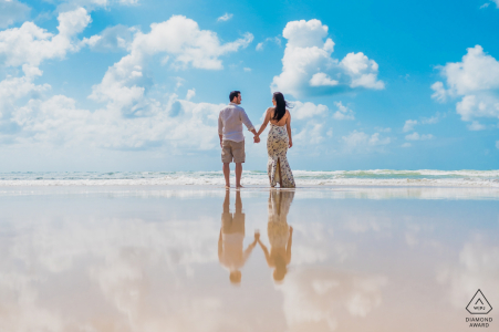 Maceió reflection couple portrait standing in the shallow waters of the ocean
