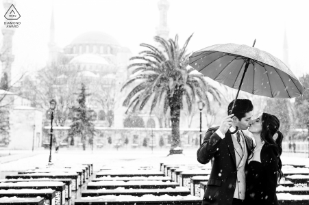 Istanbul black and white kissing couple portrait during snowy weather
