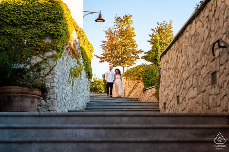 Portopiccolo, Trieste, Italy urban pic shoot before the wedding day with the couple Walking down the stairs