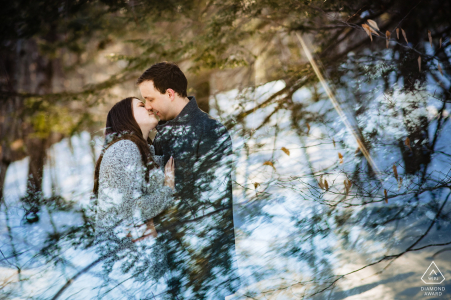 NH pre-wed portrait at the Madame Sherri Forest of a couple leaning for a kiss with reflection of the sky