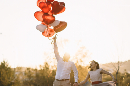 Athens, Greece pre-wed portrait of the couple appearing to be lifted by a bunch of balloons