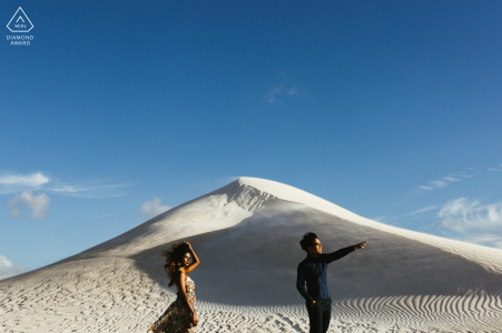Australian pre - wed image at the Lancelin Sand Dunes of a couple in Perth waiting for the first sunset in a picturesque landmark in Western Australia