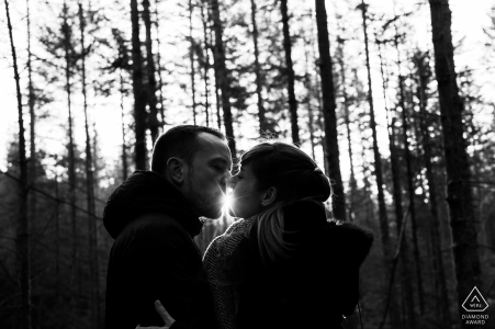 Vagney pre - wed image in BW in the trees Just before a kiss
