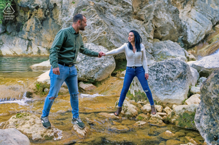 Cazorla engaged couple picture session while crossing the creek water by the rocks