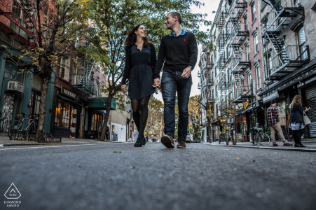 New York pre - wed image with Two lovers are walking on the NYC streets
