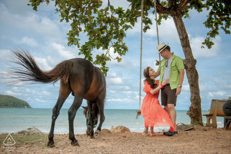 Toey Ngam Beach couple engagement pic session in Satthahip, Chonburi, Thailand during a rare moment to have an animal to witness the pre-wedding scene