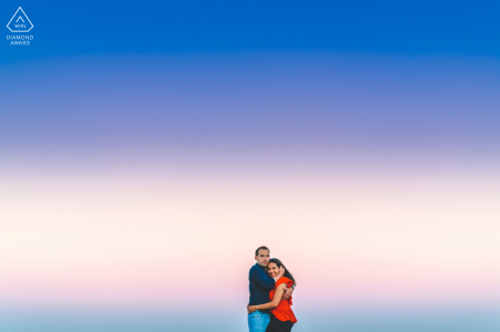 Caxias Beach pre-wed portrait in Lisbon for a Couple with the magical sky colours in the background