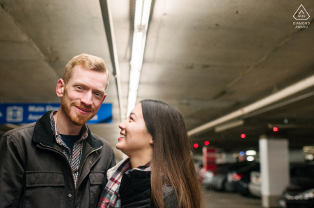 Ottawa, Ontario Artful Engagement Picture of a couple Posing under the parking garage lights for a slightly different engagement photograph